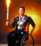 Mike Schlappi holding Paralympic Torch