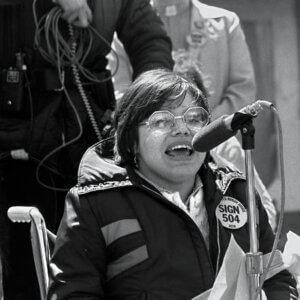 A black and white picture Judith E. Heumann at the 504 protests in the 70s.